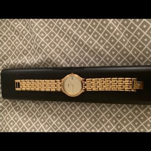 Beautiful gold Tissot Water resistant watch